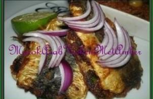 Gebakken sardines gevuld met spinazie
